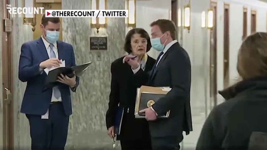 Sen. Feinstein spotted walking around Senate without a mask