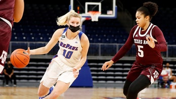 Basketball in a mask? Rare but not unheard of in pandemic