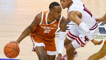 Coleman, No. 17 Texas beat Indiana 66-44 to reach Maui final