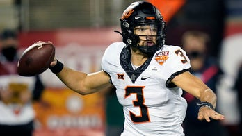 Sanders, Oklahoma State beat Miami 37-34 in Cheez-It Bowl