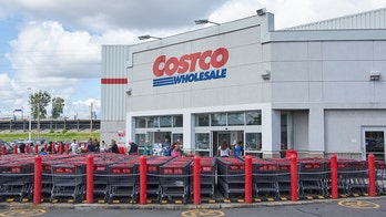 Anti-masker stands on Costco clothing display, makes false claims during megaphone rant, video shows