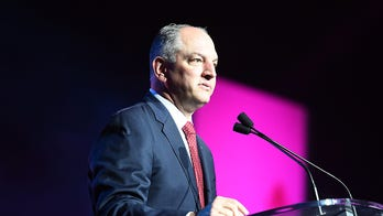 Louisiana governor plans New Year's Eve news conference amid virus surge, Letlow's death