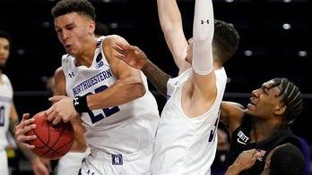 Buie, Northwestern beat No. 4 Michigan State 79-65