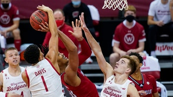 Potter leads No. 12 Wisconsin past No. 23 Louisville 85-48