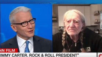 Anderson Cooper calls Willie Nelson 'very classy' for lying to shield Jimmy Carter's pot-smoking son