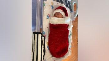 Nurses make Christmas 'onesies' for newborns to cheer up moms