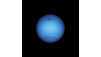Neptune's mysterious dark spot has reversed course and experts are baffled