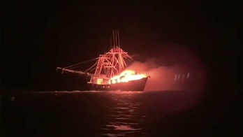 Coast Guard rescues 4 people off Alabama after vessel bursts into flames