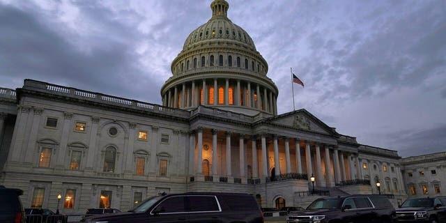 Dusk falls over the Capitol, Monday, Dec. 21, 2020, in Washington. (AP Photo/Jacquelyn Martin)