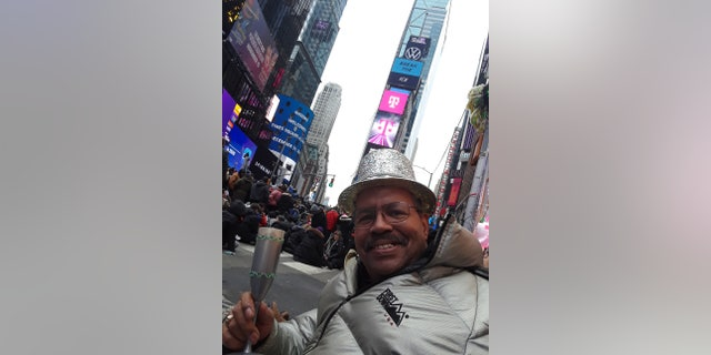 Ronald Colbert celebrating New Year's Eve in Times Square, in Manhattan on Dec. 31, 2019. As a longtime reveler, he hopes to return to the square to watch The Ball drop one last time.