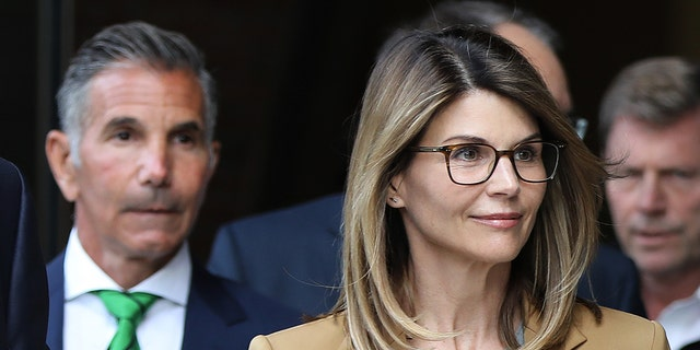 "Lori Loughlin is reportedly ""stressed"" about her husband, Mossimo Giannulli, left, still being in prison. (Getty Images)"