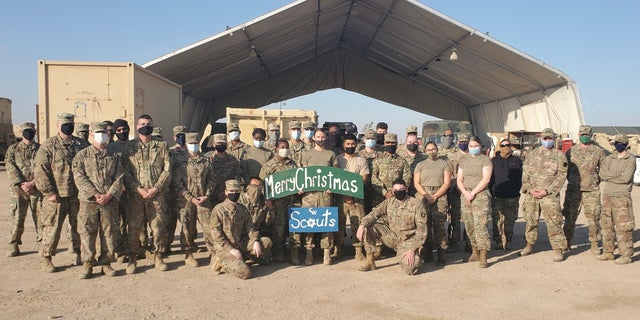 我们. Soldiers with Headquarters Support Company, 628th Aviation Support Battalion, 28th Expeditionary Combat Aviation Brigade, pose for a photo at a motor pool in the 28th ECAB's area of operations in the Middle East. Spc. Anna Schmeck, an automated logistical specialist with HSC, made a sign for her students and colleagues at Conrad Weiser West Elementary School, where she works as a teacher.