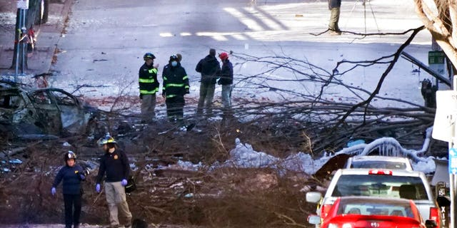 Researchers work at the explosion site in Nashville, Tennessee on Saturday, December 26, 2020.