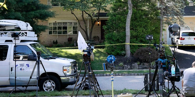 In this July 20, 2020 file photo, news media is set up outside the home of U.S. District Judge Esther Salas in North Brunswick, N.J. (Associated Press)