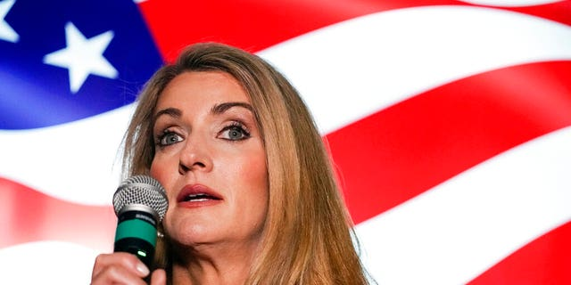 In this Nov. 13, 2020, file photo Republican candidate for U.S. Senate Sen. Kelly Loeffler speaks at a campaign rally in Cumming, Ga. Loeffler and Democratic candidate Raphael Warnock are in a runoff election for the Senate seat in Georgia. (AP Photo/Brynn Anderson, File)