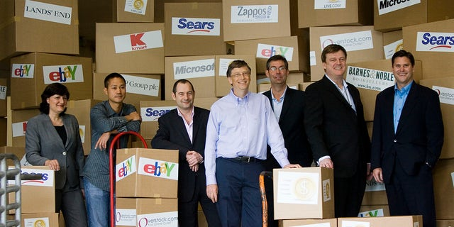 In this May 21, 2008, file photo, Marie J. Toulantis, CEO of Barnes & Noble.com; Tony Hsieh, CEO of Zappos.com; Rob Norman, CEO of GroupM Interaction Worldwide; Bill Gates, Chairman of Microsoft Corp.; Matt Ackley, VP of Internet Marketing and Advertising, eBay Inc.; Patrick Byrne, CEO of Overstock.com; and Jim Barr, President, Online, Sears Holdings, pose for a photo. (AP Photo/Stephen Brashear)