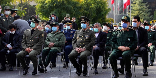 Military commanders attend the funeral of Mohsen Fahrizade, a scientist killed Friday, at a funeral in Tehran, Iran, Monday, November 30, 2020. Iran held the funeral Monday of the slain scientist who founded his military nuclear program two decades ago. the Minister of Defense of the Islamic Republic promised to continue the work of the man