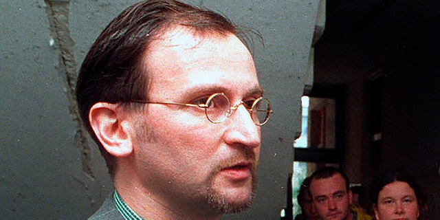In this file photo dated May 2, 1998, Jozsef Szajer, vice-president of the Fidesz Hungarian Civic Party, talks to the media. The Hungarian member of the European Parliament Jozsef Szajer admitted to being among those present at an illegal party broken up by Belgian police in central Brussels last week, amid press reports he took part in a COVID-19 lockdown sex orgy. (AP photo/Tibor Rozsahegyi, FILE)