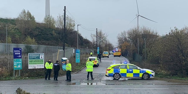 "In this photo taken with permission from the Twitter feed of @jawadburhan98, police officers attend the scene of a ""large"" explosion, Thursday Dec. 3, 2020. A local emergency services department says fire and rescue workers are responding to a report of a ""large"" explosion at a port near the southwest England city of Bristol. (@Twitter/jawadburhan98 via AP)"