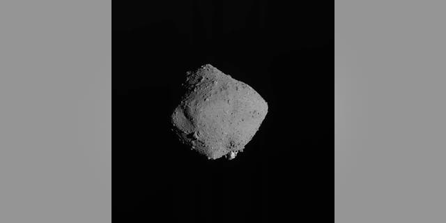 This Nov. 13, 2019, file image released by the Japan Aerospace Exploration Agency (JAXA), shows asteroid Ryugu taken by Japan's Hayabusa2 spacecraft. (JAXA via AP, File)
