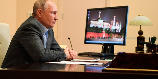 Russian President Vladimir Putin attends a meeting with participants of the We Are Together nationwide volunteer campaign via video conference at the Novo-Ogaryovo residence outside Moscow, Russia, Saturday, Dec. 5, 2020. (Alexei Nikolsky, Sputnik, Kremlin Pool Photo via AP)