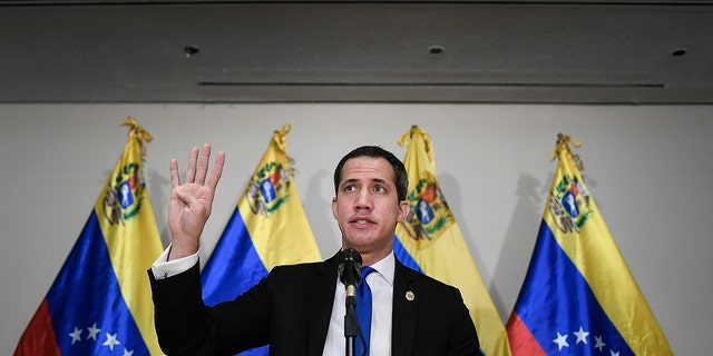 Venezuelan opposition leader Juan Guaido speaks at a press conference in Caracas, Venezuela, Saturday, Dec. 5, 2020, a day before parliamentary elections. Polling places open Sunday to elect members of the National Assembly in a vote championed by President Nicolás Maduro but rejected as a fraud by the nation's most influential opposition politicians. (AP Photo/Matias Delacroix)