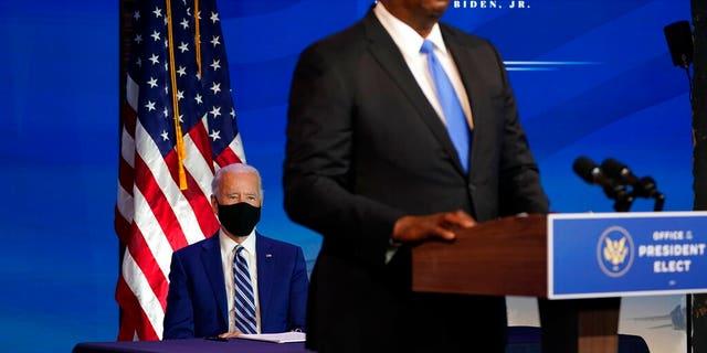 President-elect Joe Biden looks as retired Army Gen. Lloyd Austin, Biden's choice to be secretary of defense, speaks at The Queen theater in Wilmington, Del., Wednesday, Dec. 9, 2020. (AP Photo/Susan Walsh)