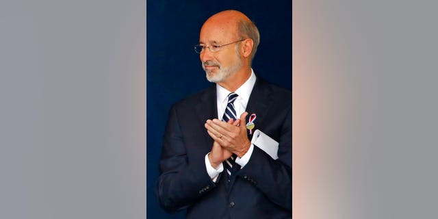 FILE - In questo settembre 11, 2018, file di foto, Pennsylvania Gov. Tom Wolf attends the September 11th Flight 93 Memorial Service in Shanksville, Bene. Gov. Wolf said Wednesday, Dic. 9, 2020, that he has tested positive for COVID-19 and was isolating at home. (AP Photo/Gene J. Puskar, File)