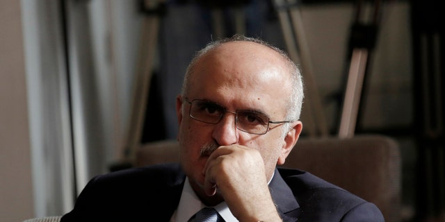 In this May 24, 2019 file photo, then-Lebanese Finance Minister Ali Hassan Khalil listens to Lebanese Information Minister Jamal Jarrah while he speaks to a journalist at the Government House in Beirut, Lebanon. (AP Photo/Hassan Ammar, File)