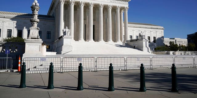 In this Nov. 4, 2020 photo, the Supreme Court in Washington. The Supreme Court justices set a deadline of Jan. 22 for Pennsylvania Secretary of State Kathy Boockvar to respond to a petition from the Trump campaign.  (AP Photo/J. Scott Applewhite)