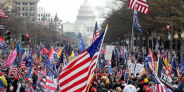 With the U.S. Capitol building in the background, supporters of President Donald Trump stand Pennsylvania Avenue during a rally at Freedom Plaza, Saturday, Dec. 12, 2020, in Washington. (Associated Press)