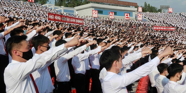 In this June 6, 2020, file photo, North Korean students stage a rally to denounce South Korea after defectors and other activists in South Korea flew anti-Pyongyang leaflets over the border, at the Pyongyang Youth Park Open-air Theatre in Pyongyang. (AP Photo/Cha Song Ho, File)