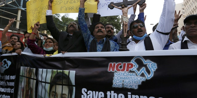 Pakistani Christians protest against child marriage and forced conversion to Islam in Karachi, Pakistan, Nov.. 8, 2020. Rights groups say each year in Pakistan, as many as 1,000 girls are forcibly converted, often after being abducted or tricked. (AP Photo/Fareed Khan)