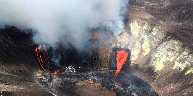 A plume rises near active fissures in the crater of Hawaii's Kilauea volcano on Monday, Dec. 21, 2020. (M. Patrick/U.S. Geological Survey via AP)