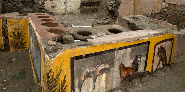 An undated photo made available by the Pompeii Archeological park press office shows the thermopolium in the Pompeii archeological park, near Naples, Italy. (Luigi Spina/Parco Archeologico di Pompei via AP)
