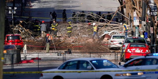 Investigators continue to examine the site of an explosion Sunday, Dic. 27, 2020, in downtown Nashville, Tenn.