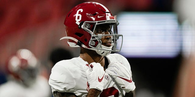 Alabama wide receiver DeVonta Smith (6) warms up before the first half of the Southeastern Conference championship NCAA college football game against Florida, Saturday, Dec. 19, 2020, in Atlanta. (AP Photo/Brynn Anderson)