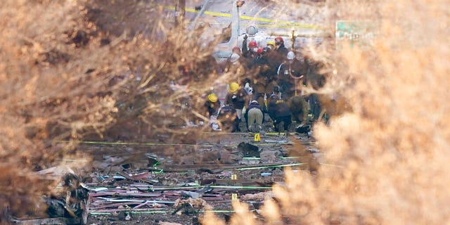 Investigators continue to look through the site of an explosion Monday, Dec. 28, 2020, in Nashville, Tenn.