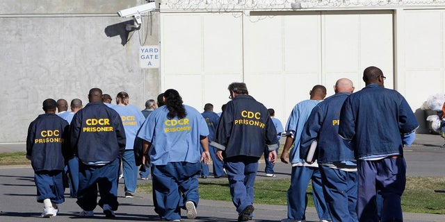 In this Feb. 26, 2013, file photo, inmates walk through the exercise yard at California State Prison Sacramento, near Folsom, Calif. The California Supreme Court ruled Monday, Dec. 28, 2020, that inmates convicted of what the state defines as nonviolent sex crimes cannot be denied a chance at earlier release under a ballot measure approved by nearly two-thirds of voters four years ago.