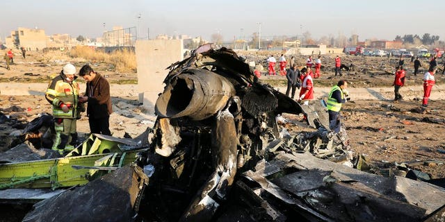 LÊER: Debris litters the scene where a Ukrainian plane crashed in Shahedshahr southwest of the capital Tehran, Iran.