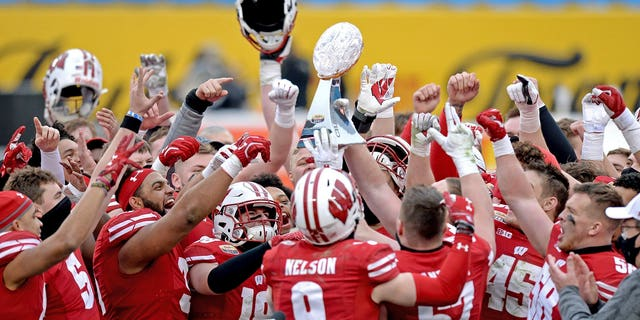 On Wednesday, December 30, 2020, the Wisconsin players won the trophy after beating Wake Forest in the Duke University Mayo Cup NCAA college football game at Bank of America Stadium in Charlotte, North Carolina.  (Associated Press)