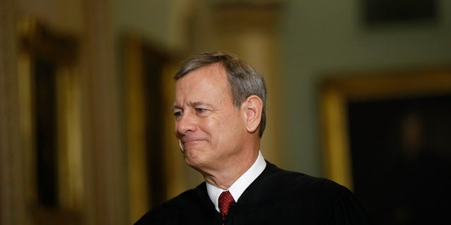 In this Jan. 16, file photo Chief Justice of the United States, John Roberts walks to the Senate chamber at the Capitol in Washington. Roberts praised state and federal courts in his year-end report. (AP Photo/Matt Rourke, File)