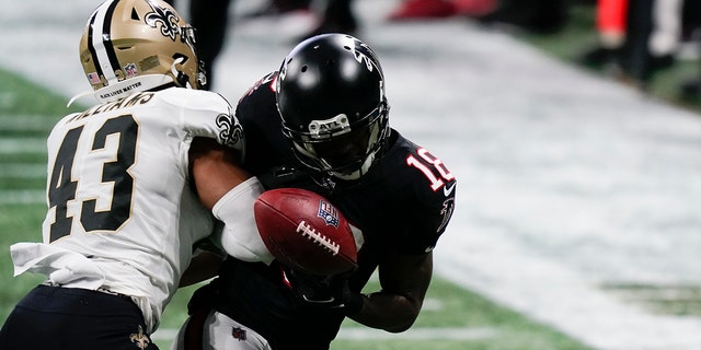 New Orleans Saints free safety Marcus Williams (43) hits Atlanta Falcons wide receiver Calvin Ridley (18) during the second half of an NFL football game, Sunday, Dec. 6, 2020, in Atlanta. (AP Photo/Brynn Anderson)