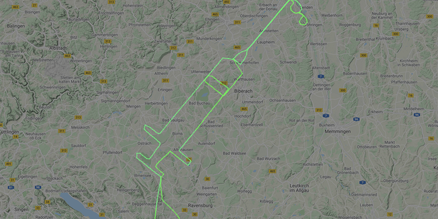 A pilot in Germany traced a giant syringe in the air.