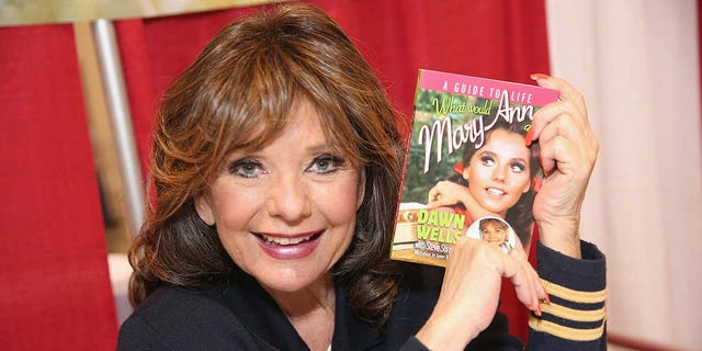 Dawn Wells in 2014, with her book 'What Would Mary Ann Do? A Guide to Life,' which she co-wrote with Steve Stinson.