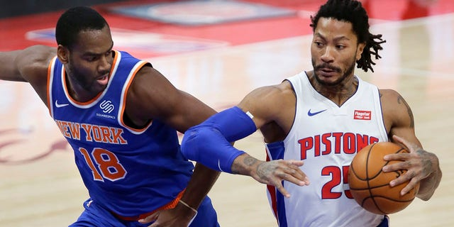 Detroit Pistons guard Derrick Rose (25) drives to the basket against New York Knicks guard Alec Burks (18) during the first half of an NBA basketball game Sunday, Dec. 13, 2020, in Detroit. (AP Photo/Duane Burleson)
