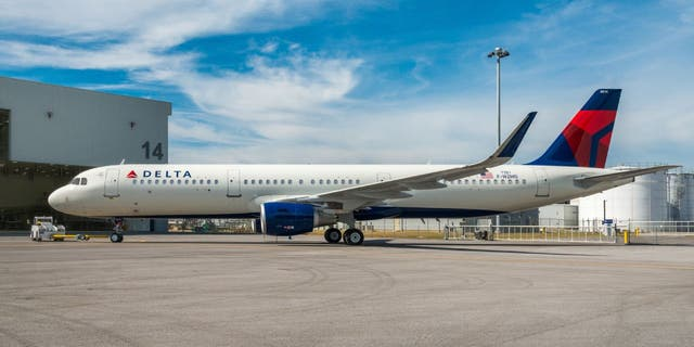 Two passengers and a service dog exited a Delta Air Lines flight through the emergency slide at LaGuardia Airport in Queens, N.Y. (Delta Air Lines)