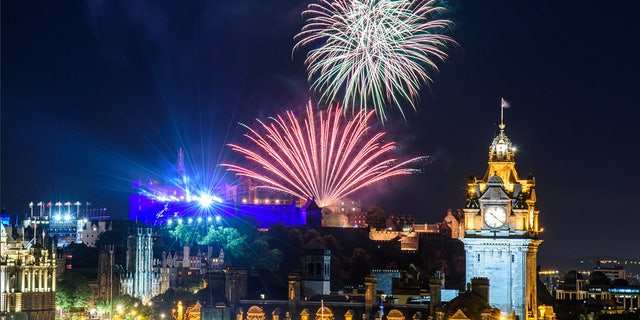 Edinburgh, Scotland - August 15, 2017: The scenic summer fireworks in Edinburgh during the Royal Military Tattoo and Fringe Festival.