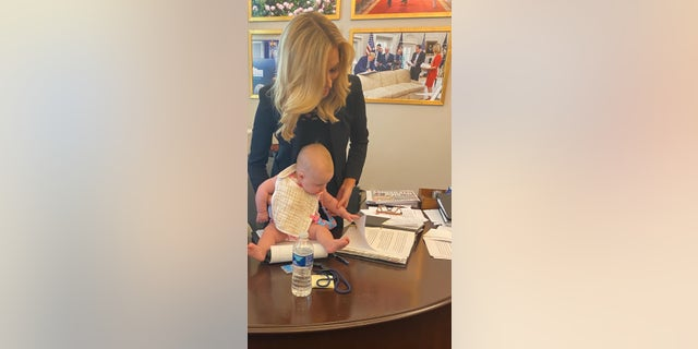 McEnany and her daughter, Blake, in her office at the White House.