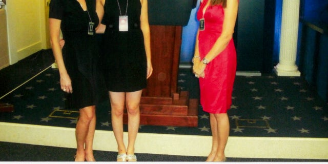 McEnany and her mother and aunt in the White House press briefing room in Spring 2008, during her internship in the Bush White House.